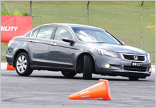 Stability at ease - Accord 3.5L turning at the 'Half Circle' test during the Skid Control in  Advanced Driving category.