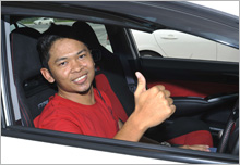 Mr. Amirul Imran bin Amirin, giving the thumbs up while waiting for his turn to go on track.