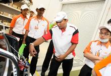 HMRT Member, Mohd Faizul, Chief Fuel Man of HMRT explaining about HMRT Race Car 27 to TOC students