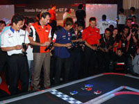 (From Left) Mr. Katsuyuki Hiranaka, race driver from Nakajima Racing, Mr. Ralph Firman, race driver of Autobac Racing Team Aguri, Mr. Yuji Ide from Team Kunimitsu and Mr. Toshihiro Kanieshi, race driver from Real Racing with Leon challenging each other in a game of remote-controlled cars.