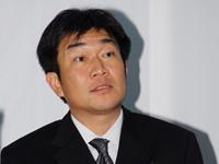Mr. Atsushi Fujimoto speaking at press conference.