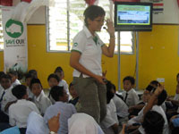 Students interacting excitingly with invited speaker on environment, Ms. Daisy Poh.