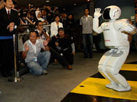 ASIMO dancing with the crowd.
