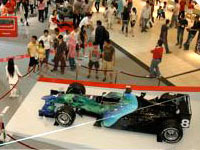 Shoppers finding out more about the Honda Racing F1 roadshow in Penang