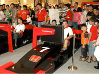 Just like an F1 event - Participants and their fans at the Honda F1 Simulator border=