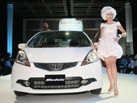 Taffeta White All-New Jazz with Modulo accessories together with a model showcasing a design piece from Khoon Hooi (Themed 'Space')
