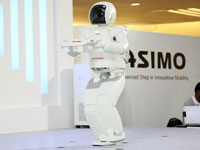 ASIMO's capability of carrying a tray while walking.