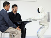 ASIMO can now serve drinks, making him one step closer to become a possible assistant to humans in the future.