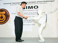 ASIMO's improved abilities to interact with people and serve items, making him a possible assistant in our society.