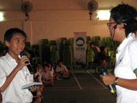 Standard 5 student Anthony Richardo Tan Guan Hong, 11, interacting with speaker Ms. Daisy Poh during the talk.