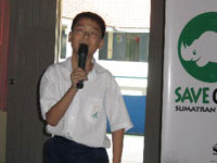 Standard 5 student Aaron Lim Pek Qin, 11, sharing his thoughts on the environment with his schoolmates.