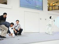 ASIMO plays futsal with the audience.