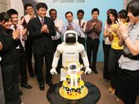Managing Director and Chief Executive Officer of Honda Malaysia, Mr Atsushi Fujimoto and associates sing ASIMO a Happy Birthday song.