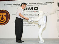 ASIMO can now serve drinks, making him one step closer to become a possible assistant to human in the future.