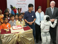 ASIMO celebrates the fund 20th Anniversary with the beneficiaries by singing them a Happy Birthday song.