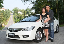 Michelle Lu and husband Jack Ma with their Civic Hybrid - They purchased the car because of its environment-friendly technology and fuel efficiency.