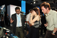 A product specialist explaining the engine specifications of the 2nd Generation Jazz to listening customers.