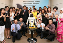 A group photo with ASIMO after celebration.