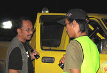 Night Patrolling Wardens inspecting on one of the vehicles entering the jungle